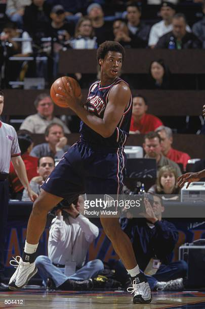 Forward Jason Collins of the New Jersey Nets holds the ball during the NBA game against the Golden State Warriors at the Arena in Oakland in Oakland...