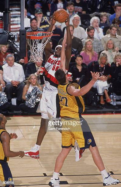 Forward Zach Randolph of the Portland Trail Blazers dunks over forward Primoz Brezec of the Indiana Pacers during the NBA game at the Rose Garden in...