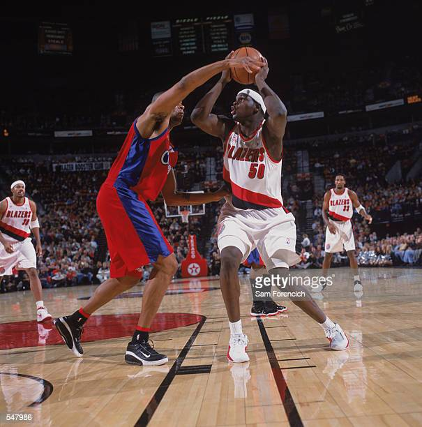 Forward Zach Randolph of the Portland Trail Blazers looks to shoot over forward Sean Rooks of the Los Angeles Clippers during the NBA game at the...