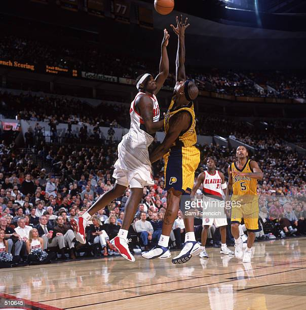Forward Zach Randolph of the Portland Trail Blazers shoots over forward Al Harrington of the Indiana Pacers during the NBA game at the Rose Garden in...