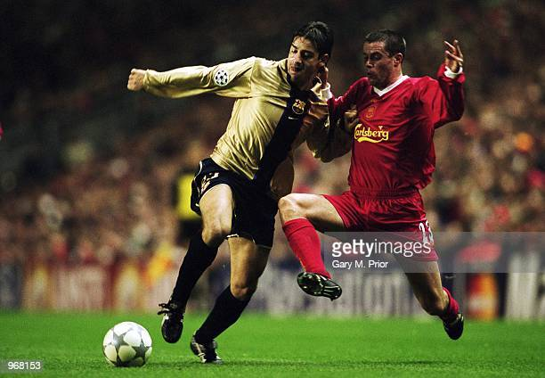 Francesco Coco of Barcelona takes the ball past Jamie Carragher of Liverpool during the UEFA Champions League Group B match played at Anfield in...