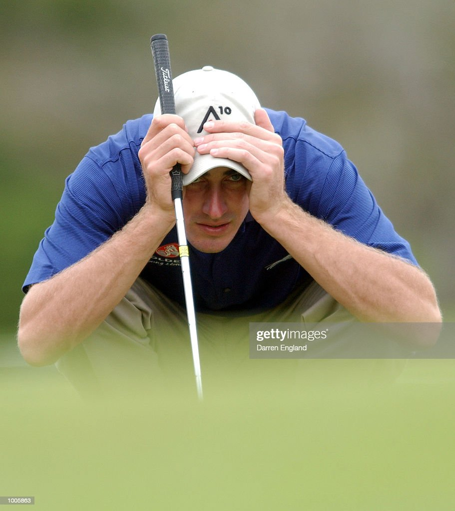 Geoff Ogilvy of Australia lines up his putt on the 14th green during the first round of the Australian PGA Championship being played at Royal Queensland Golf Club in Brisbane, Australia. He finished his round at one under par. DIGITAL IMAGE. Mandatory Credit: Darren England/ALLSPORT