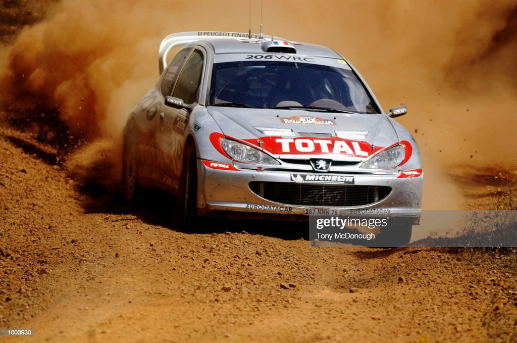 Gilles Panizzi and co-driver, Herve Panizzi put their Peugeot 206 WRC to the test on the outback bush tracks around Mundaring during the 19.98 km Special Stage Flynn's Short of Leg 1 of the Telstra Rally Australia at Perth, Australia. DIGITAL IMAGE Mandatory Credit: Tony McDonough/ALLSPORT