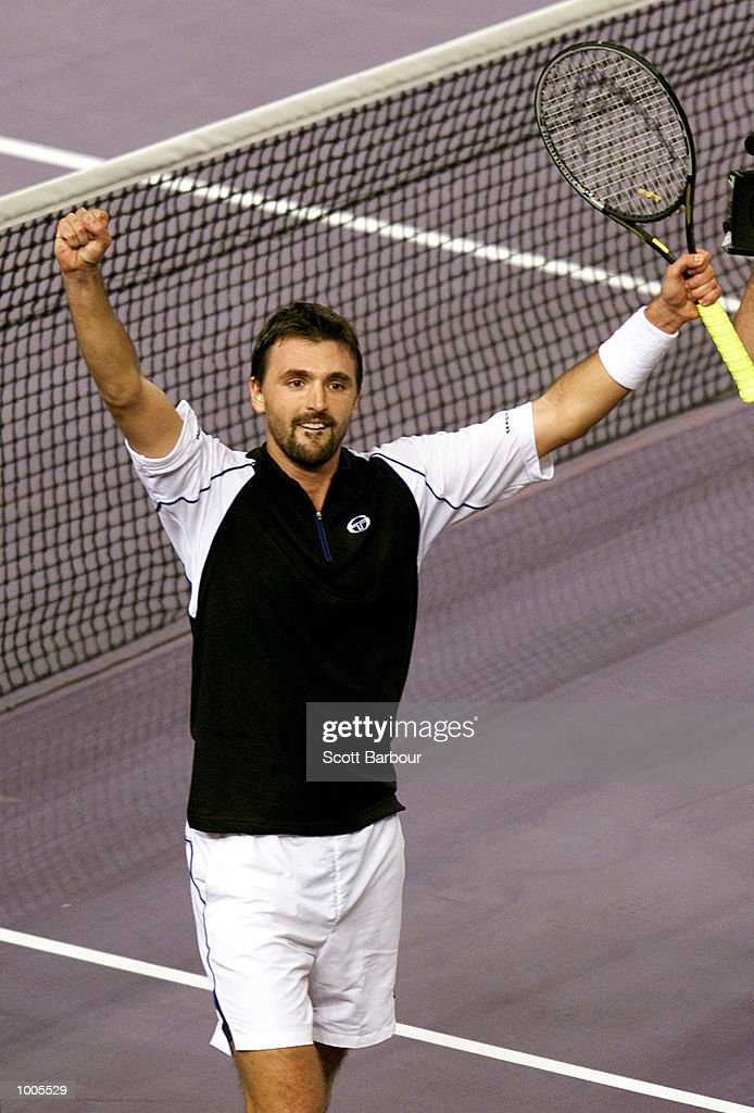 Goran Ivanisevic of Croatia celebrates after defeating Gustavo Kuerten of Brazil during day two of the Tennis Masters Cup held at the Sydney Superdome in Sydney, Australia. DIGITAL IMAGE. Mandatory Credit: Scott Barbour/ALLSPORT