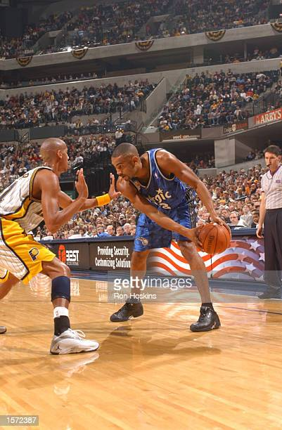 Grant Hill of the Orlando Magic pauses against Reggie Miller of the Indiana Pacers during the first half at Conseco Fieldhouse in Indianapolis...