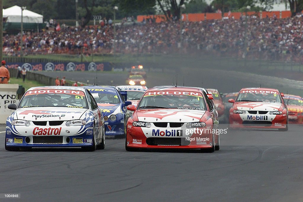 Greg Murphy #51 (L) in his Holden Commodore VX races down the first straight next to championship winner Mark Skaife #1 in his Commodore VX during the first race of Round 12 Shell Championship at Pukekohe Park Raceway, south of Auckland, New Zealand. Mark Larkham was awarded the race ahead of Greg Murphy after a red flag decision which took the race back a lap to give Larkham the win. Mandatory Credit: Nigel Marple/ALLSPORT