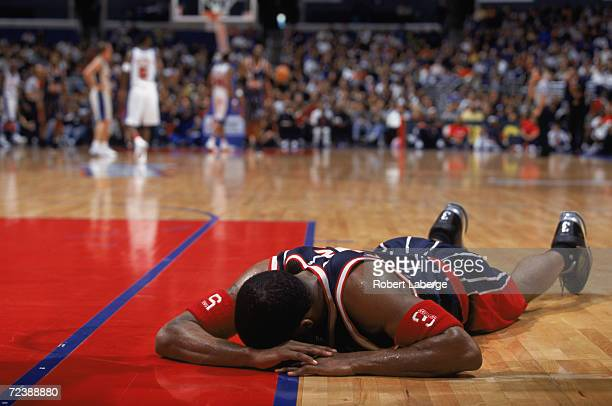 Guard Cuttino Mobley of the Houston Rockets writhes in pain during the NBA game against the Los Angeles Clippers at the Staples Center in Los Angeles...