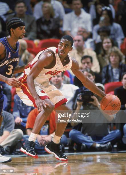 Guard Eddie Jones of the Miami Heat dribbles the ball during the NBA game against the Washington Wizards at American Airlines Arena in Miami Florida...