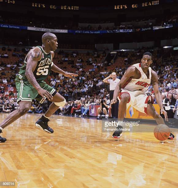 Guard Eddie Jones of the Miami Heat drives past forward Eric Williams of the Boston Celtics during the NBA game at American Airlines Arena in Miami...