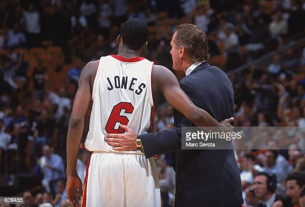 Guard Eddie Jones of the Miami Heat listens to head coach Pat Riley during the NBA game against the Minnesota Timberwolves at American Airlines...