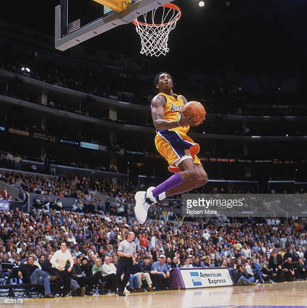 Guard Kobe Bryant of the Los Angeles Lakers dunks the ball during the NBA game against the Sacramento Kings at the Staples Center in Los Angeles,...
