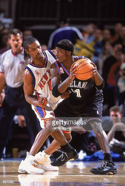 Guard Ricky Davis of the Cleveland Cavaliers holds the ball away from guard Latrell Sprewell of the New York Knicks during the NBA game at Madison...
