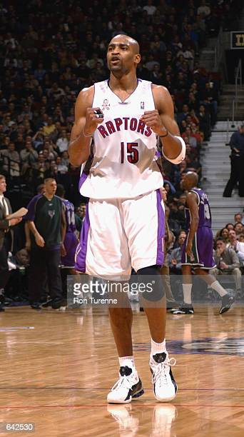 Guard Vince Carter of the Toronto Raptors celebrates during the NBA game against the Milwaukee Bucks at the Air Canada Centre in Toronto, Canada. The...