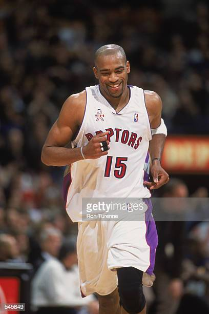 Guard Vince Carter of the Toronto Raptors jogs and smiles during the NBA game against the Golden State Warriors at Air Canada Centre in Toronto,...
