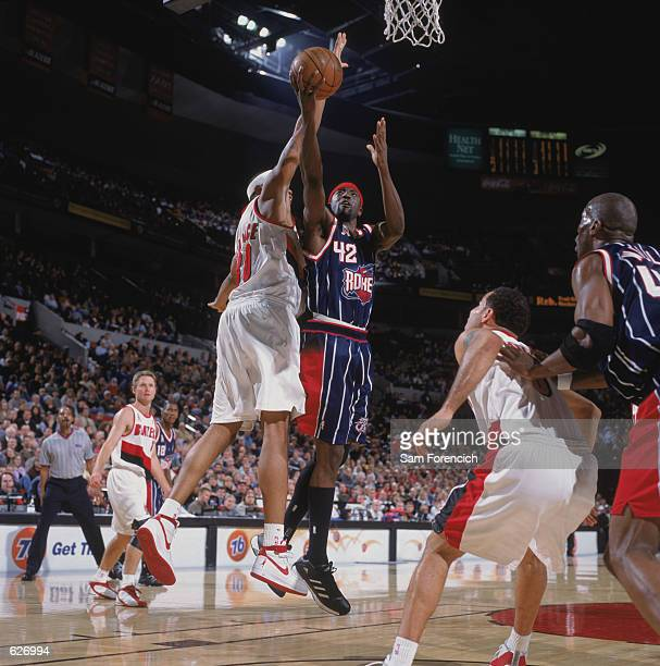Guard Walt Williams of the Houston Rockets shoots past forward Rasheed Wallace of the Portland Trail Blazers during the NBA game at the Rose Garden...