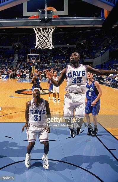 Guards Jumaine Jones and Ricky Davis of the Cleveland Cavaliers wait for the rebound during the NBA game against the Orlando Magic at Gund Arena in...