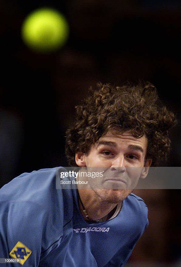 Gustavo Kuerten of Brazil in action during his match against Yevgeny Kafelnikov of Russia during pool play of the Tennis Masters Cup held at the Sydney Superdome in Sydney, Australia. DIGITAL IMAGE. Mandatory Credit: Scott Barbour/ALLSPORT
