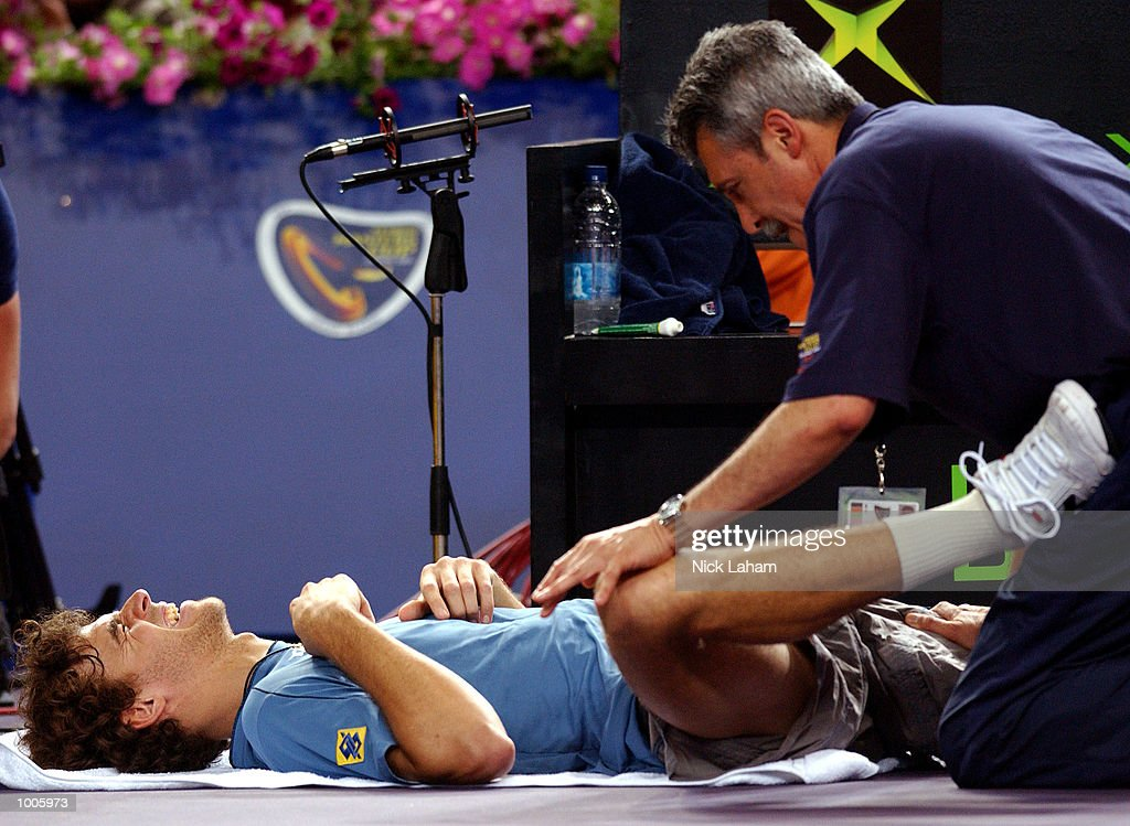 Gustavo Kuerten of Brazil receives treatment during his match against Yevgeny Kafelnikov of Russia during the Tennis Masters Cup held at the Sydney Superdome, Sydney, Australia. DIGITAL IMAGE Mandatory Credit: Nick Laham/ALLSPORT