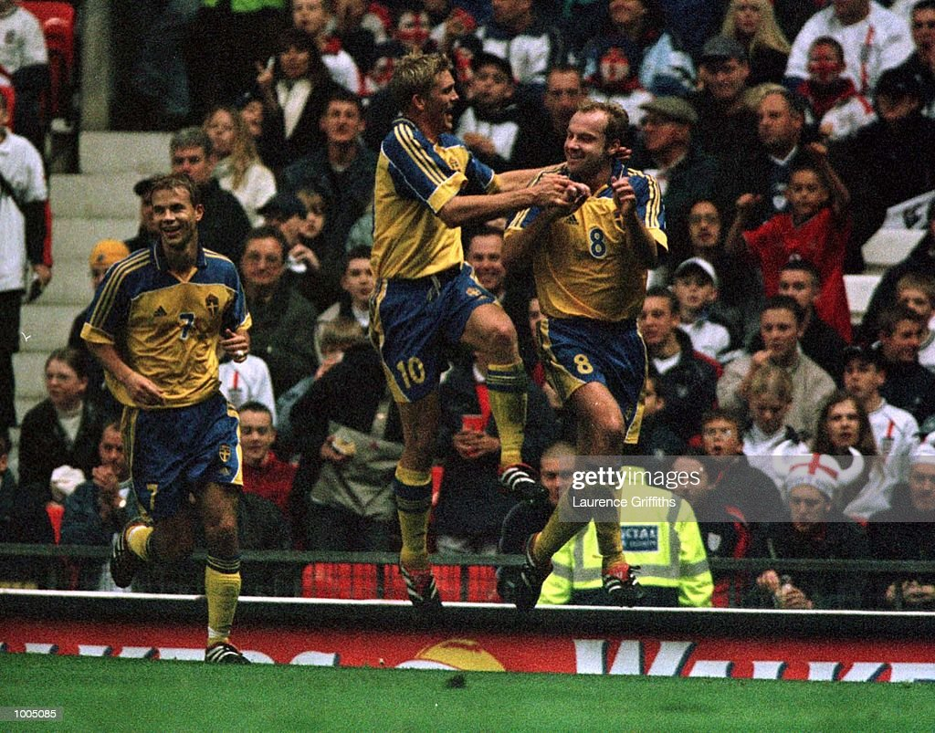 Hakan Mild of Sweden celebrates with Marcus Allback after scoring the equalising goal during the England v Sweden International friendly at Old Trafford, Manchester. Mandatory Credit: Laurence Griffiths/ALLSPORT