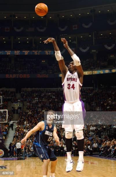 ee6026e827b Hakeem Olajuwon of the Raptors puts up a shot as Steve Nash of the  Mavericks looks