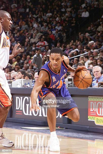 Howard Eisley of the New York Knicks dribbles the ball against the Golden State Warriors at The Arena in Oakland California DIGITAL IMAGE NOTE TO...
