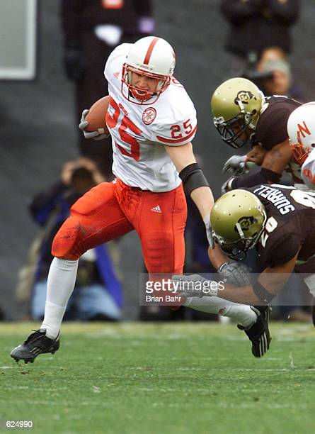 Iback Josh Davis of the Nebraska Cornhuskers slips around the Colorado Buffaloes in the first quarter at Folsom Field in Boulder Colorado DIGITAL...