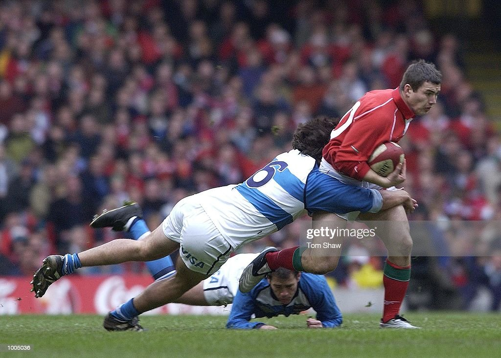Iestyn Harris of Wales evades a tackle during the Wales v Argentina International friendly match at the Millennium Stadium, Cardiff. DIGITAL IMAGE. Mandatory Credit: Tom Shaw/ALLSPORT