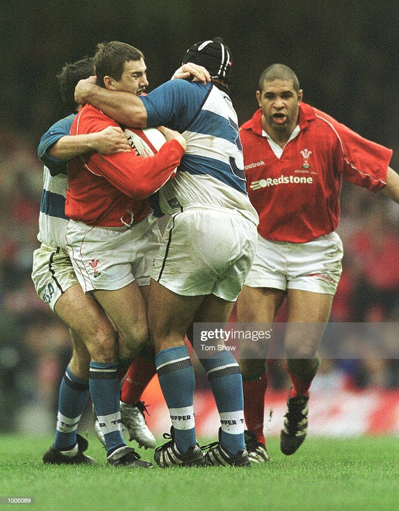 Iestyn Harris of Wales tries to break free from a tackle during the Wales v Argentina International Friendly at the Millennium Stadium, Cardiff. Mandatory Credit: Tom Shaw/ALLSPORT