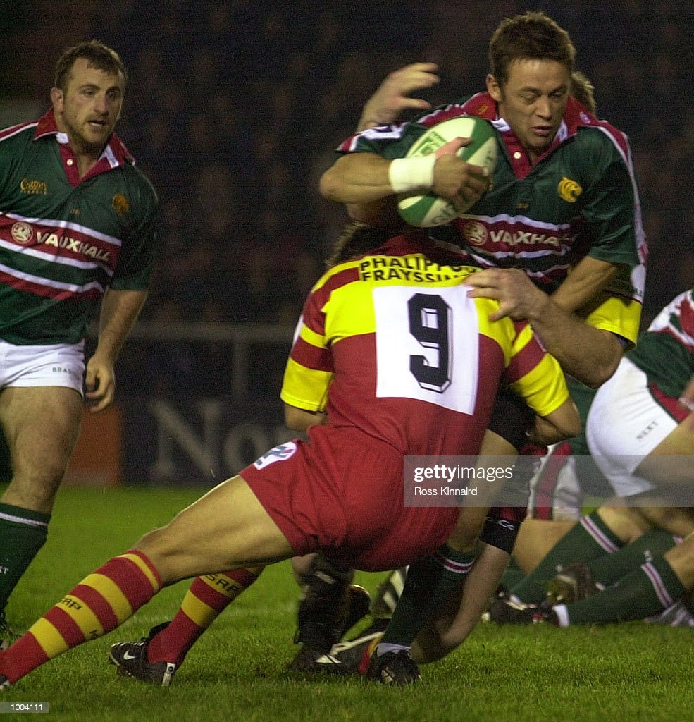 Jamie Hamilton of Leicester tackled by Ludovic Loustau of Perpignan during the Leicester Tigers v Perpignan Heineken Cup match at Welford Road, Leicester. DIGITAL IMAGE. Mandatory Credit: Ross Kinnaird/ALLSPORT