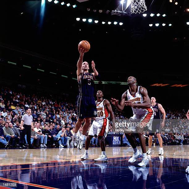 Jason Kidd of the New Jersey Nets drives to the basket for a layup against the Golden State Warriors during a NBA game at The Arena in Oakland...