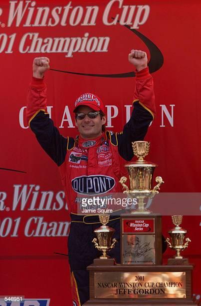 Jeff Gordon celebrates wins the championship at the NASCAR Winston Cup NAPA 500 at the Atlanta Motor Speedway in Hampton Georgia Digital Image...