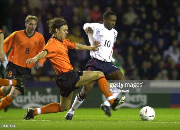 Jermain Defoe of England gets past Jos Van Nieuwstadt of Holland during the match between England U21 and Holland U21 in the European Qualifying...