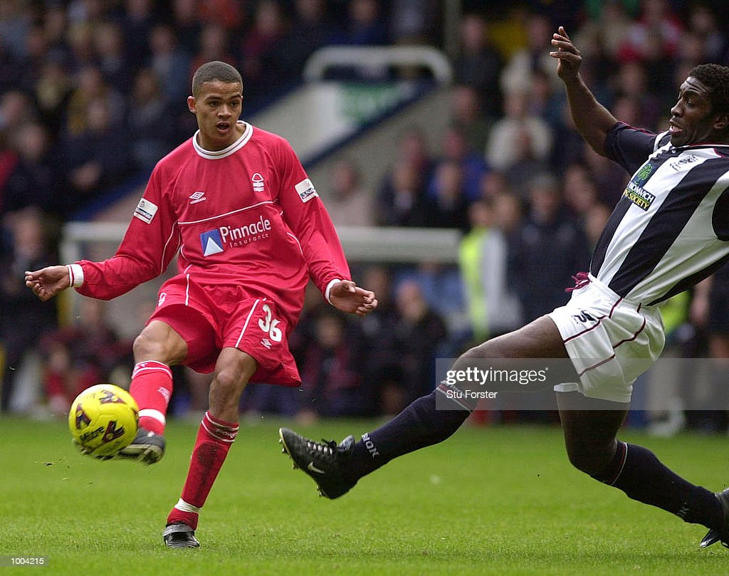 Jermaine Jenas of Nottingham Forest shoots past the outstretched leg of Darren Moore of West Brom during the Nationwide League Division One match between West Bromwich Albion and Nottingham Forest at The Hawthorns, West Bromwich. DIGITAL IMAGE Mandatory Credit: Stu Forster/ALLSPORT