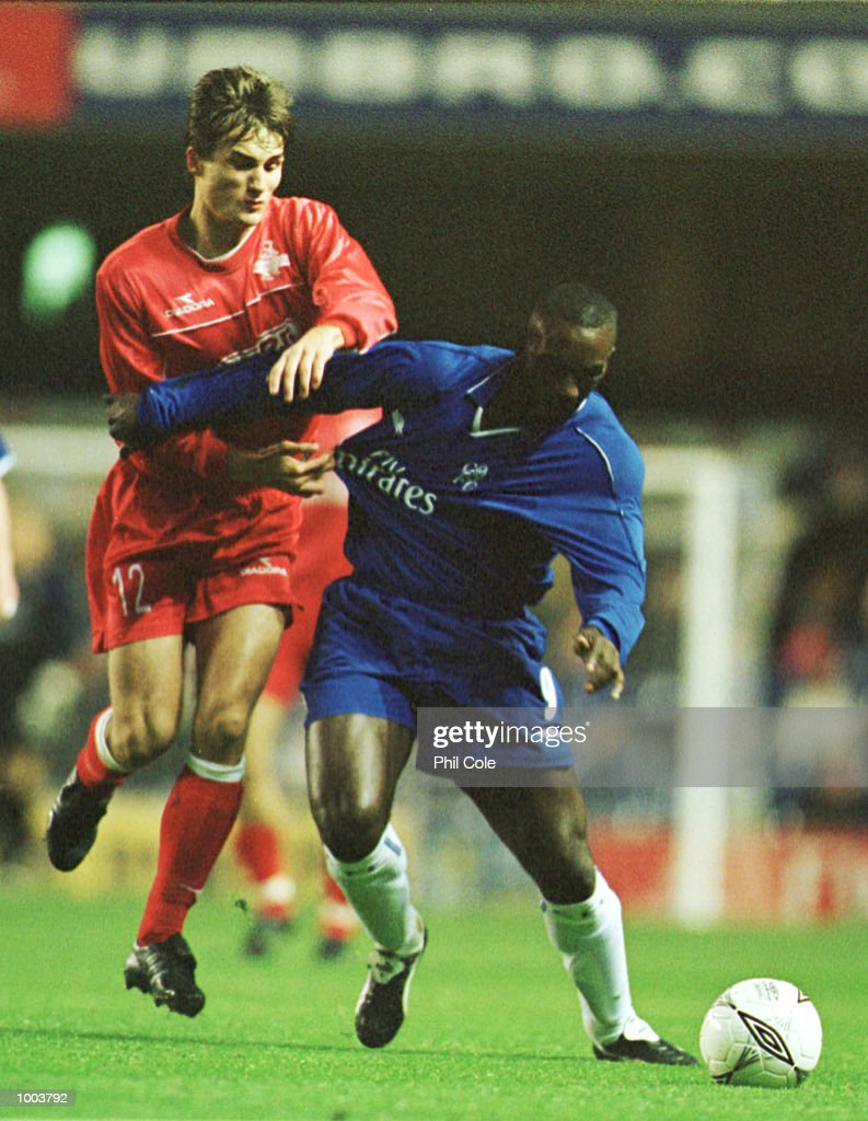 Jimmy Floyd Hasselbaink of Chelsea fends off a challenge from Denys Onyschenko of Tel-Aviv during the UEFA Cup 2nd round, 2nd leg match between Chelsea FC and Hapoel Tel-Aviv at Stamford Bridge, London. Mandatory Credit: Phil Cole/ALLSPORT