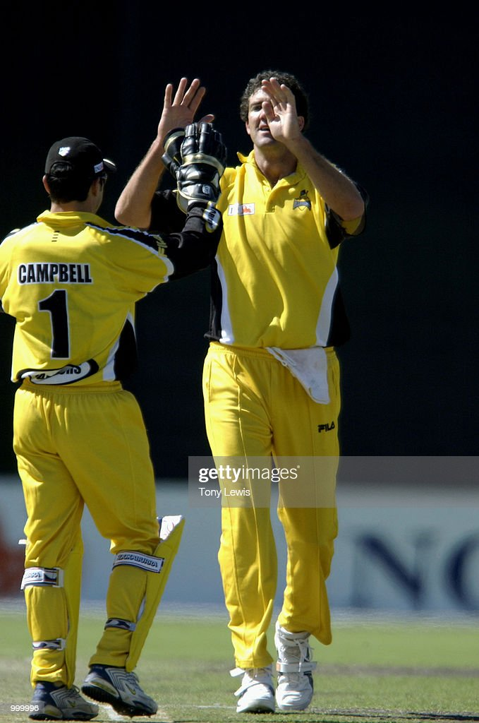 Jo Angel of West Australia celebrates with keeper Ryan Campbell after he bowled Chris Davies for 40 in the ING Cup day-night match between Western Australia and South Australia played at Adelaide Oval in Adelaide, Australia. DIGITAL IMAGEMandatory Credit: Tony Lewis/ALLSPORT