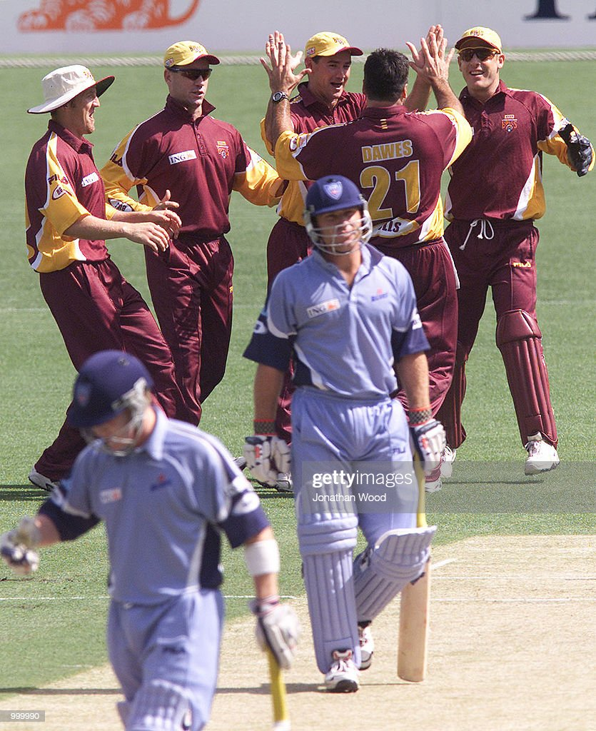 Joe Dawes of Queensland celebrates a wicket with teamates during the ING Cup match between the Queensland Bulls and the New South Wales Blues played at the Gabba, Brisbane, Australia. DIGITAL IMAGE. Mandatory Credit: Jonathan Wood/ALLSPORT