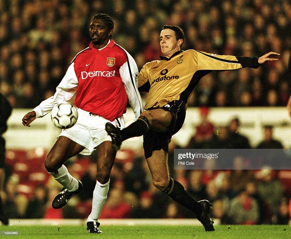 John O'' Shea of Manchester United tries to tackle Kanu of Arsenal during the Worthington Cup, Third Round match between Arsenal and Manchester United at Highbury, London. Mandatory Credit: Phil Cole/ALLSPORT