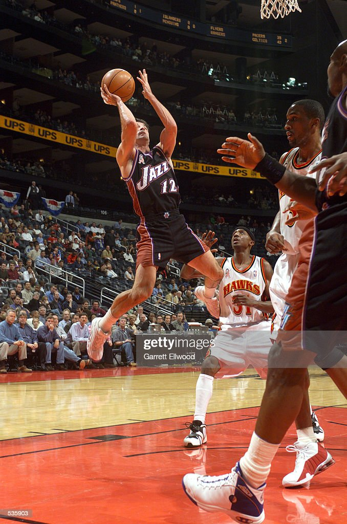 John Stockton #12 of the Utah Jazz shoots a fall away jump shot against the Atlanta Hawks during a game at Phillips Arena in Atlanta, Georgia.