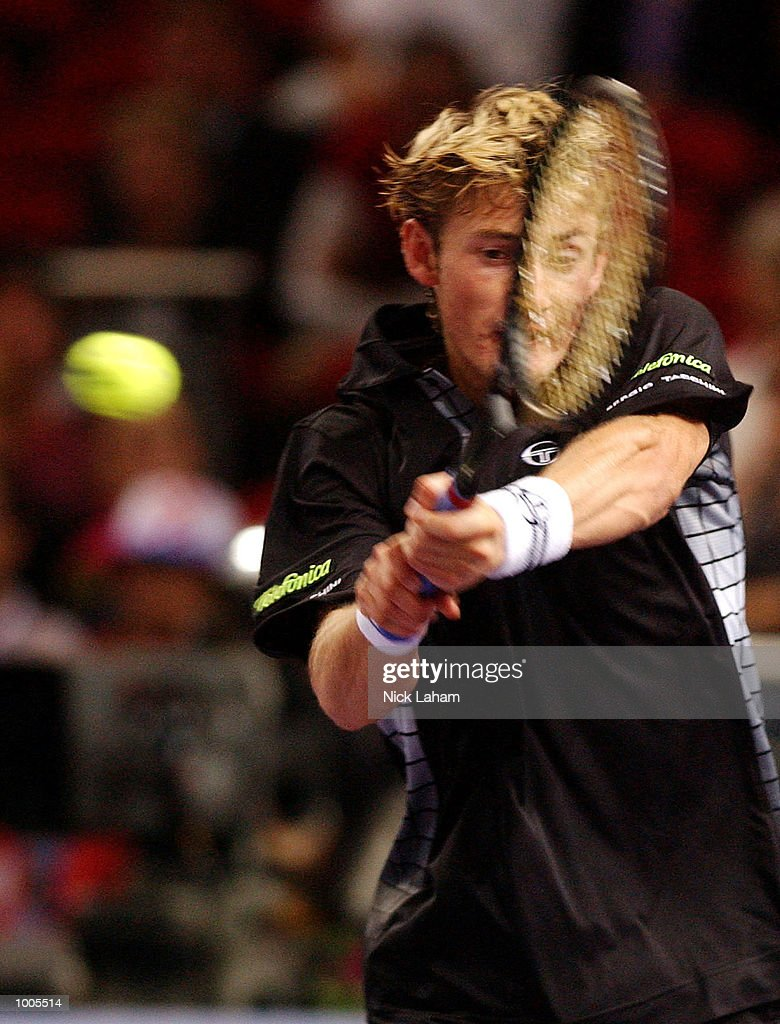 Juan Carlos Ferrero of Spain in action against Yevgeny Kafelnikov of Russia during the Tennis Masters Cup held at the Sydney Superdome, Sydney, Australia. DIGITAL IMAGE Mandatory Credit: Nick Laham/ALLSPORT