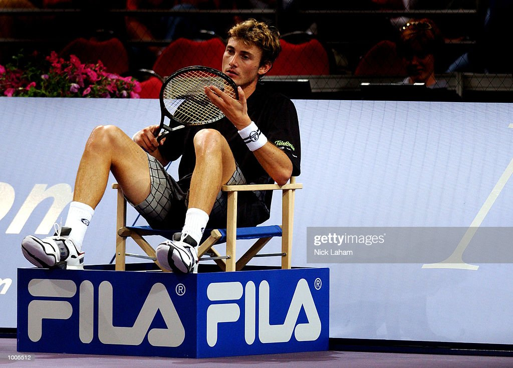 Juan Carlos Ferrero of Spain takes some time out against Yevgeny Kafelnikov of Russia during the Tennis Masters Cup held at the Sydney Superdome, Sydney, Australia. DIGITAL IMAGE Mandatory Credit: Nick Laham/ALLSPORT