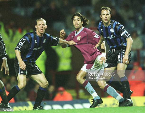 Juan Pablo Angel of Aston Villa is held off by Robbie Mustoe of Middlesbrough and Gareth Southgate during the FA Barclaycard Premiership match...
