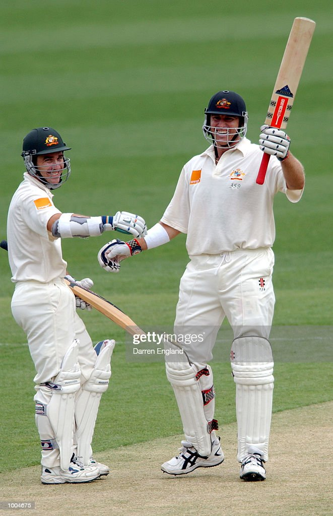 Justin Langer and Matthew Hayden of Australia celebrate Hayden's century against New Zealand during day one of the first Cricket test between Australia and New Zealand played at the Gabba in Brisbane, Australia. DIGITAL IMAGE. Mandatory Credit: Darren England/ALLSPORT