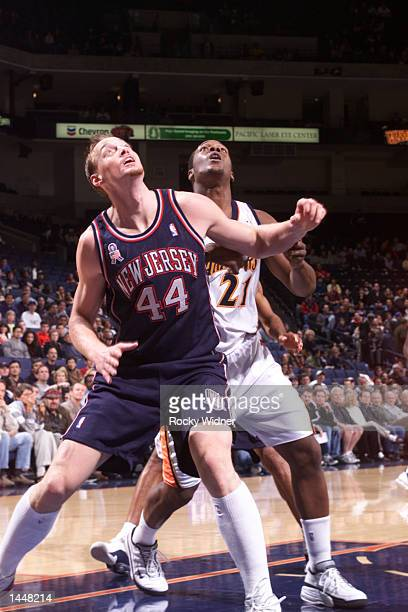 Keith Van Horn of the New Jersey Nets and Danny Fortson of the Golden State Warriors position themselves for the rebound during a game at The Arena...