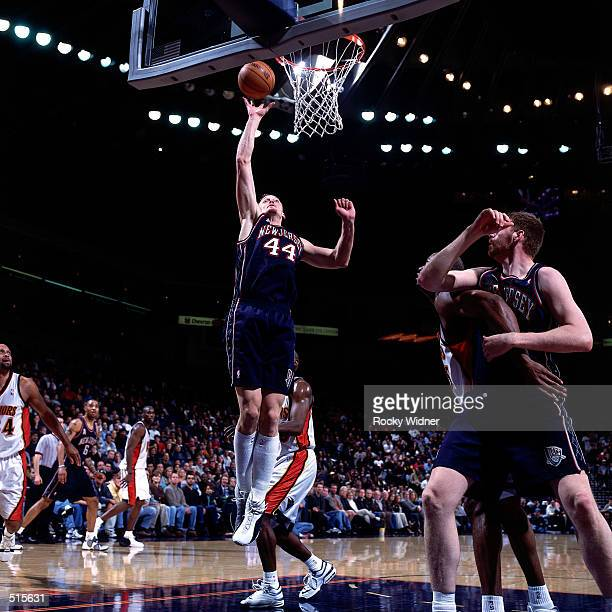 Keith Van Horn of the New Jersey Nets drives to the basket for a layup against the Golden State Warriors during a NBA game at The Arena In Oakland...