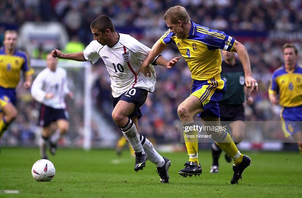 Kevin Phillips of England battles with Johan Mjallby of Sweden during the England v Sweden International friendly at Old Trafford, Manchester. DIGITAL IMAGE Mandatory Credit: Ross Kinnaird/ALLSPORT