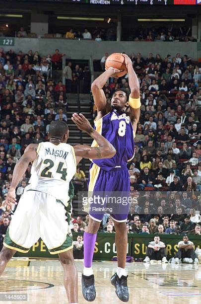 Kobe Bryant of the Los Angeles Lakers shoots over Desmond Mason of the Seattle SuperSonics at Key Arena in Seattle Washington DIGITAL IMAGE Note to...