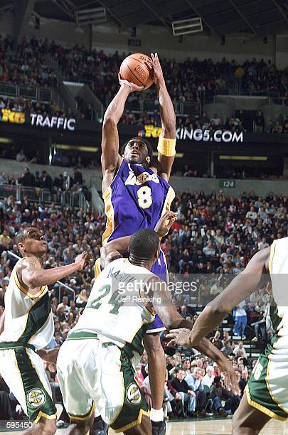 Kobe Bryant of the Los Angeles Lakers shoots over Desmond Mason of the Seattle SuperSonics at Key Arena in Seattle, Washington. DIGITAL IMAGE. Note...