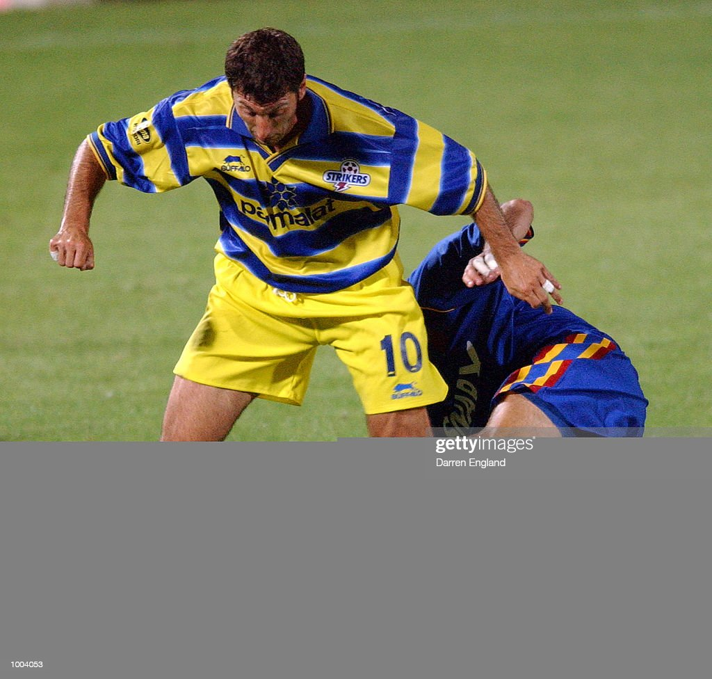 Kris Trajanovski #10 of the Strikers is tackled by a Spirit player during the NSL round 5 match between the Brisbane Strikers and the Northern Spirit played at Ballymore in Brisbane, Australia. DIGITAL IMAGE. Mandatory Credit: Darren England/ALLSPORT