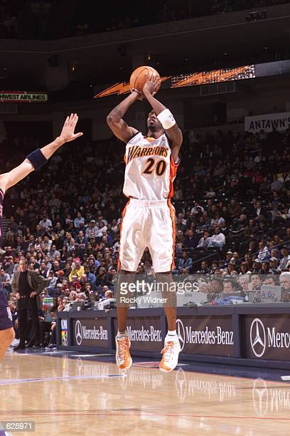 Larry Hughes of the Golden State Warriors attempts a 3pointer against the New Jersey Nets at The Arena in Oakland California DIGITAL IMAGE NOTE TO...