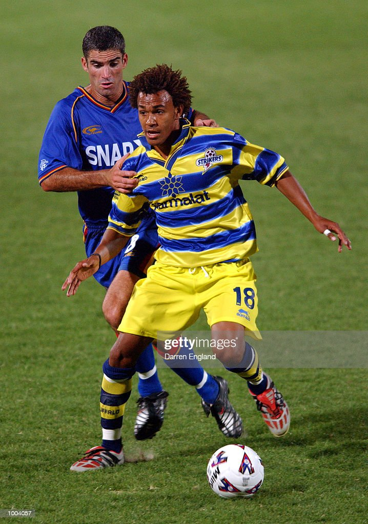 Lawrence Drake #18 of the Strikers gets past the tackle of Craig Foster #8 of the Spirit during the NSL round 5 match between the Brisbane Strikers and the Northern Spirit played at Ballymore in Brisbane, Australia. DIGITAL IMAGE. MandatoryCredit: Darren England/ALLSPORT